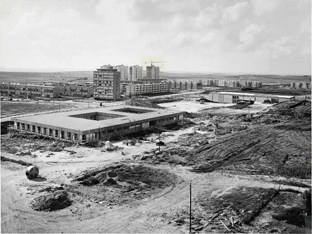 The expansion of the campus with the Gilman Building under construction